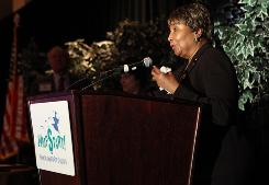 Rep. Eddie Bernice Johnson, D-Texas, recieves an award for personal finance education from the Jump$tart Coalition in Washington in 2009. Johnson says she wrongly steered scholarships from the Congressional Black Caucus to her relatives.