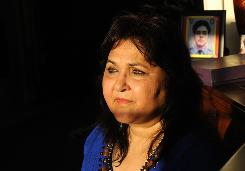 Talat Hamdani, whose son Salman, an EMT, died when the World Trade Center collapsed on 9/11, sits at her home in Lake Grove, N.Y.