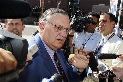 The U.S. Justice Department is suing Joe Arpaio, seen Thursday in Phoenix, saying the Arizona sheriff refused for more than a year to turn over records in an investigation into allegations his department discriminates against Hispanics.