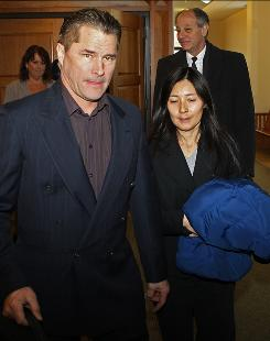 Richard and Mayumi Heene leave court after sentencing on Dec. 23 in Fort Collins, Colo.