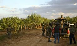 Army soldiers stop at a dirt road after a raid and gun battle on the vicinity of Ciudad Mier, northern Mexico, near the U.S. border on Thursday.