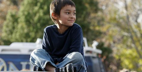 Falcon Heene, 6, sits on the roof of his family's van outside his home in Fort Collins, Colo., on Oct. 15 after he was found hiding in a box in a space above the garage.
