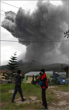 Mount Sinabung spews volcanic materials into the sky as seen from Tanah Karo on Friday.  Mount Sinabung had last erupted in 1600, and government vulcanologists acknowledged they had made no efforts before the mountain started rumbling last week to sample gases or look for rising magma or other signs of seismic activity.