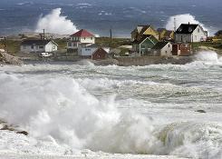 Waves pound the coast at Peggys Cove, Nova Scotia, on Saturday as Earl passes through.