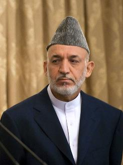 Afghan President Hamid Karzai, seen here during a press conference in Kabul on Thursday, said Saturday he will soon name members of a council charged with pursuing peace talks with rebels willing to break with al-Qaeda.