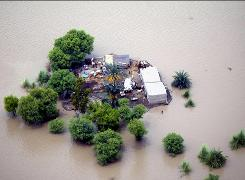 An aerial view shows an island farm trapped by floodwaters which threaten their precarious existence, in the flooded taunsa area in southern Pakistan on Aug. 14.  The floods that already devastated one crop in the fields are threatening the next season's crop as well, an aftershock aid workers fear could add to Pakistan's misery and prolong the crisis.