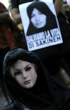 "Protesters gather in front of the Iranian Embassy in Rome to support Sakineh Mohammadi Ashtiani, who is being punished for having an ""illicit relationship outside marriage"" after the death of her husband."