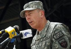 Gen. David Petraeus, commander of the NATO and U.S. forces in Afghanistan seen here speaking in Kabul in July, criticized a Florida church's threats to burn the Quran, saying it could endanger U.S. troops.