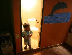 Edward Nino Hernandez, 24, stands in the doorway of his bathroom in Bogota, Colombia, on Sunday. Nino is recognized as the world's shortest man in the new Guinness World Records.