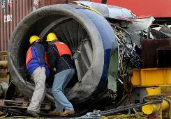 "The engine from the US Airways jet involved in the ""Miracle on the Hudson"" accident is examined Jan. 23, 2009, after being pulled onto a barge."