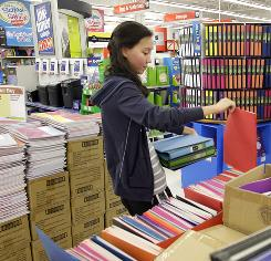 Justine Frerichs shops for school supplies at Staples in Columbus, Ohio.