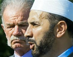 Imam Muhammad Musri, right, from the Islamic Society of Central Florida, said Thursday at a news conference in Gainesville, Fla., that Pastor Terry Jones, left, will cancel the planned burning of the Quran.