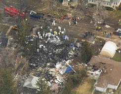 An aerial view of the site where Continental Connection Flight 3407 crashed into a home on Long Street in Clarence, N.Y., is seen Feb. 14, 2009.