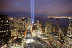 "The ""Tribute in Light"" shines Friday above the World Trade Center site and lower Manhattan."