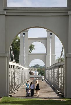 The Waco Suspension Bridge, finished in 1870, is now a pedestrian recreational bridge that crosses the Brazos River.