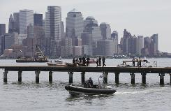 Emergency personnel work at the scene of a helicopter crash on the Hudson River in Hoboken, N.J., on Aug. 8, 2009.