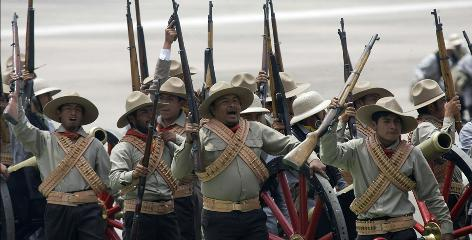 Members of the Mexican army re-enact historic battles, including that of Chapultepec, which was fought exactly 163 years ago, during celebrations for the bicentennial.