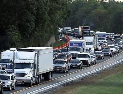 Traffic backs up Saturday on the New York State Thruway near Harriman, N.Y., after a church van crash resulted in multiple fatalities.
