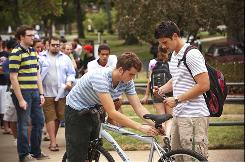 Jason Dallam, left, adjusts a bike Blake Bodendorfer checked out for the semester from Drury University on Aug. 30.
