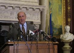 Wisconsin Gov. Jim Doyle said Monday in Madison he was troubled by news that  Calumet County District Attorney Ken Kratz sent inappropriate text messages to a domestic abuse victim.