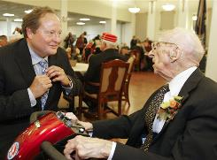 Montana Gov. Brian Schweitzer, left, jokes with Walter Breuning during a birthday party for the 114-year-old Breuning in Great Falls on Tuesday.