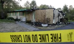 Realtor Vivian Martin, 67, was found dead on the kitchen floor in this burned out home in Youngstown, Ohio. Two real estate agents were killed in vacant homes for sale and another was robbed, all within a week.