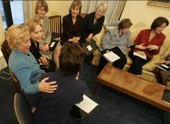 Female members of the Senate gather for a meeting in the Hart Senate Office Building on Nov. 14, 2006.