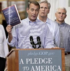 "House Minority Leader John Boehner of Ohio holds a copy of the GOP agenda, ""A Pledge to America,"" which includes proposals on government spending and the economy."