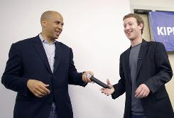 Newark Mayor Cory A. Booker, left, introduces Facebook CEO Mark Zuckerberg to 11th grade math students at the KIPP Newark Collegiate Academy, in Newark, on Saturday.
