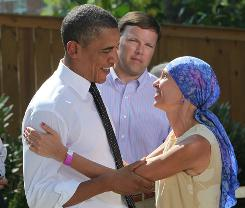President Obama talks with Gail O'Brian from New Hampshire who is receiving treatment for cancer as he answers questions about the Health Care Plan with a group Wednesday in Falls Church, Virginia.