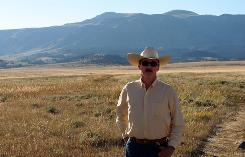 Rancher Dave Grabbert stands on the 2,500-acre ranch in northern Wyoming that he wants to sell to a group of Roman Catholic monks.