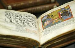 In this photo taken Friday, a late 12th century illuminated gospels manuscript in Greek,  which has been digitized, is seen at the British Library in London. British Library has digitized over a quarter of its Greek manuscripts (284 volumes) for the first time and made them freely available online.