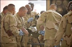 A U.S. serviceman injured in an IED blast is transported from a medevac helicopter flight to the trauma bay at a medical treatment facility in Kandahar, Afghanistan, on Sept. 18.