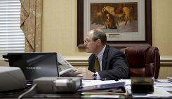  Richard Holland Jr., President of Farmers Bank, sits in his Windsor, Va., office. Compensation didn't make up for the way the case darkened his life and his parents' last days.
