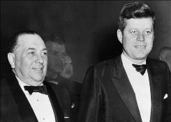 Chicago Mayor Richard J. Daley, left, stands beside President John Kennedy in Chicago in March of 1963.