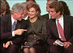 President Clinton, left, gestures as he speaks with Jacqueline Kennedy Onassis and her son John F. Kennedy Jr. during re-dedication ceremonies at the John F. Kennedy Library and Museum Oct. 29,1993 in Boston.
