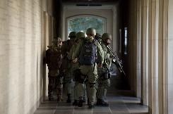 Police prepare to enter Calhoun Hall at the University of Texas in Austin on Tuesday after a gunman opened fire inside the Perry-Castaneda Library and fatally shot himself.