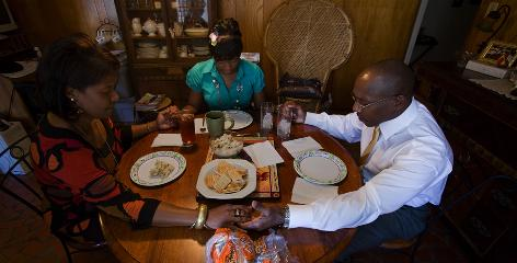 Vel Grundy, 52, left, Monika, 26, and Art, 53, enjoy Sunday lunch together. Monika Grundy lived in her own apartment in Jonesboro, Ark., for three years but moved back to her parents' home in Memphis after losing her job.