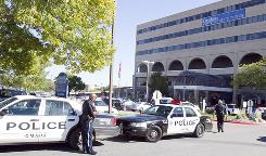 Police are seen in front of the Creighton University medical center in Omaha, Wednesday, after two officers were shot and a suspect was critically injured.