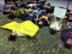 "A group participates in a ""lie-in"" near the Student Center at Rutgers University in New Brunswick, N.J., on Wednesday to support safe places for gay students."