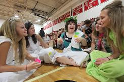 Chester (S.D.) High School Homecoming Queen Betsy Daniel, center, 18, jokes with friends, from left, Kaylie Eich, Becca Rohlck, Haley Larson and Logan Reinhiller on toga day Sept. 16.