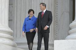 New Supreme Court Justice Elena Kagan and Chief Justice Roberts walk down the west steps of the Supreme Court building after Kagan's investiture on Friday.