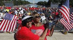 Jackie Livingston, right, and Pat Williams, sisters from Trenton, N.J., join activists in Washington, D.C., on Saturday for the One Nation Working Together rally aimed at promoting a number of progressive causes.