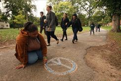 Alicia Whavers of Newark takes part in the &quot;You Are Loved&quot; chalk project at Drew University.