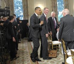 """President Obama, left, meets members of his Economic Recovery Advisory Board on Monday. Obama says he wants """"to join students looking for jobs with businesses looking to hire."""""""