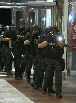 Members of law enforcement agencies conduct training exercises in Pecanland Mall in Monroe, La., on Aug. 26.
