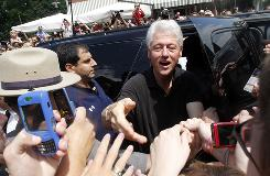 Former president Bill Clinton greets well-wishers July 30 as he leaves Gigi's restaurant in Rhinebeck, N.Y. He has been campaigning for Democratic candidates in tossup races around the country.