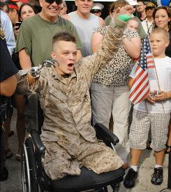 Marine Cpl. Tyler Southern celebrates Aug. 20 after his arrival at his Jacksonville home. Southern was awarded a Purple Heart after he lost both legs and an arm to an improvised explosive device in Afghanistan.