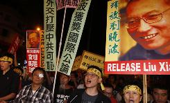 Pro-democracy protesters hold the picture of Chinese dissident Liu Xiaobo with Chinese words 'Release Liu Xiaobo' during a demonstration outside the China's Liaison Office in Hong Kong on Friday.