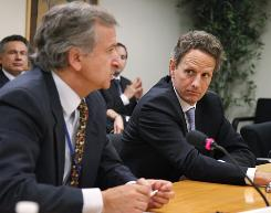 Treasury Secretary Timothy Geithner looks on as Chilean Finance Minister Felipe Larrain makes remarks during  the IMF-World Bank 2010 Annual Meetings in Washington on Saturday.